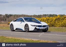 Bmw I8 White - a white bmw i8 hybrid electric sports car drives through the new