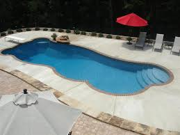 exterior modern grey flooring around pool with white diving