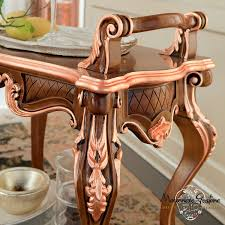 dining room with hardwood walnut furniture and copper leaf