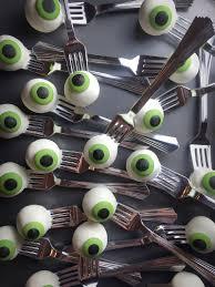 eyeball cake pops on silver forks so fun for halloween