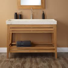 bathroom trough sink with white sink and wood legs plus wood