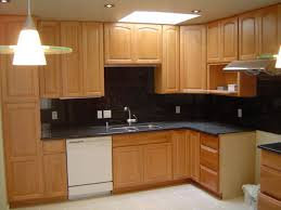 Maple kitchen cabinets, maple hardwood floors, and granite