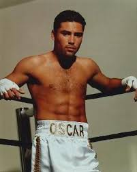 Oscar De La Hoya helps break