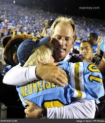 Rick Neuheisel and son Joe