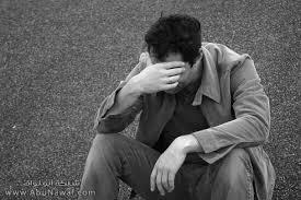 http://t3.gstatic.com/images?q=tbn:gxQv9UoSEVv2qM:http://images.abunawaf.com/2007/05/12/Sad_Man.jpg
