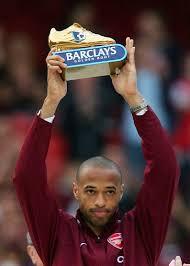 Arsenals Henry holds aloft