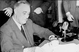 FDR signs the Selective Service Training Act