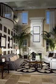 Cook Brothers Living Room Furniture by 2 Story Great Room With White Fireplace Mezzanine Looking Down On