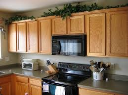 Above Kitchen Cabinet Decorations Pictures by 100 Above Kitchen Cabinets Space Above Kitchen Cabinets
