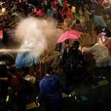Thai police fire water cannon at Bangkok protesters