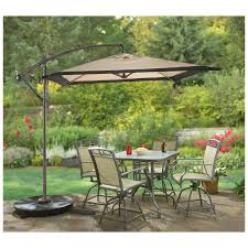 Sears Canada Patio Umbrella by Square Offset Patio Umbrella Over Patio Table And Chairs Set And