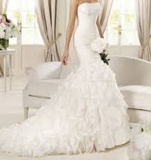 أجمل فساتين الزفاف 2013 images?q=tbn:ANd9GcT