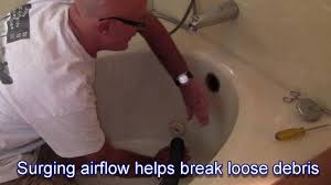 Natural Remedy For Clogged Bathroom Drain by How To Clear A Bathtub Drain With A Shop Vac Youtube