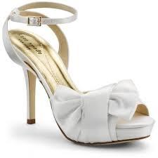 أحذية باللون الأبيض images?q=tbn:ANd9GcT